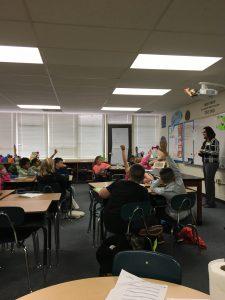 Banker teaching an elementary school class
