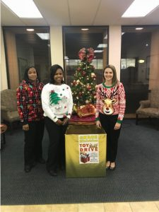 Toy drive box with employees around it