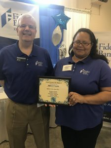 An award being given to a Fidelity Bank Associate