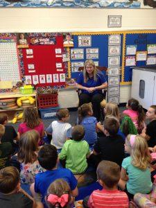 Fidelity Bank employee teaching a class of children