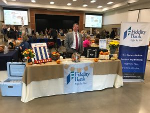 Fidelity Bank table and employee at a convention for small businesses