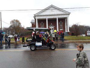 A golf cart going through a Mount Gilead Parade