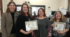 Mebane Employees Pose for a Photo with their awards