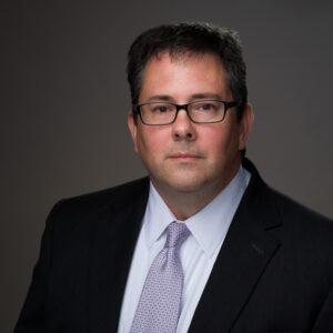 Portrait of Jebb Graff, a man in glasses