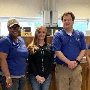 Fidelity Team posing in bank