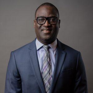 Portrait of TJ Sallah, a man in glasses