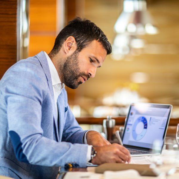 Entrepreneur writing on a document