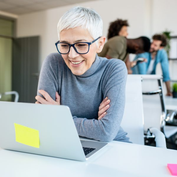 Woman looking at her work laptop