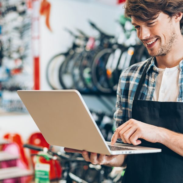 Bike shop owner with laptop