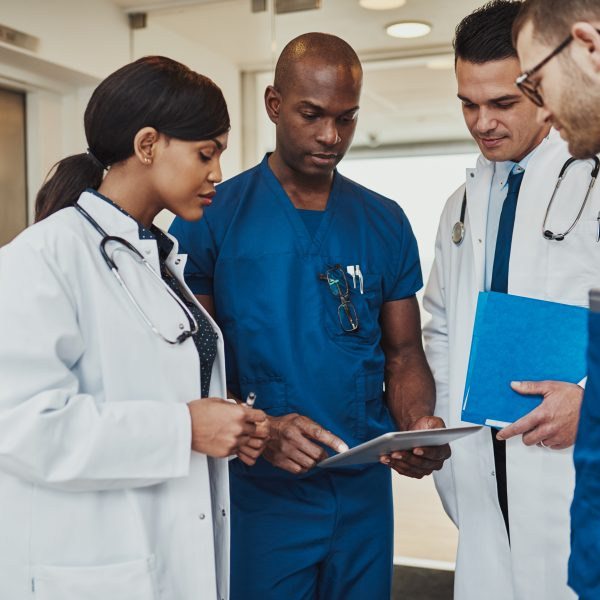 Multiracial team of doctors discussing a patient