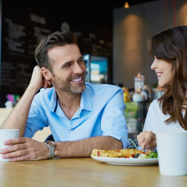 two people talking over a meal