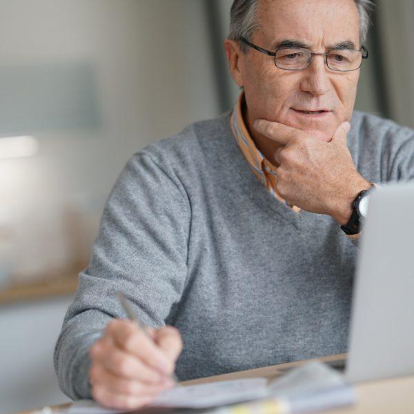 man looking at his laptop