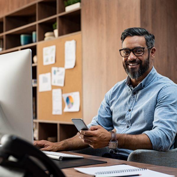 Smiling,Business,Man,Wearing,Eyeglasses,Working,On,Desktop,Computer